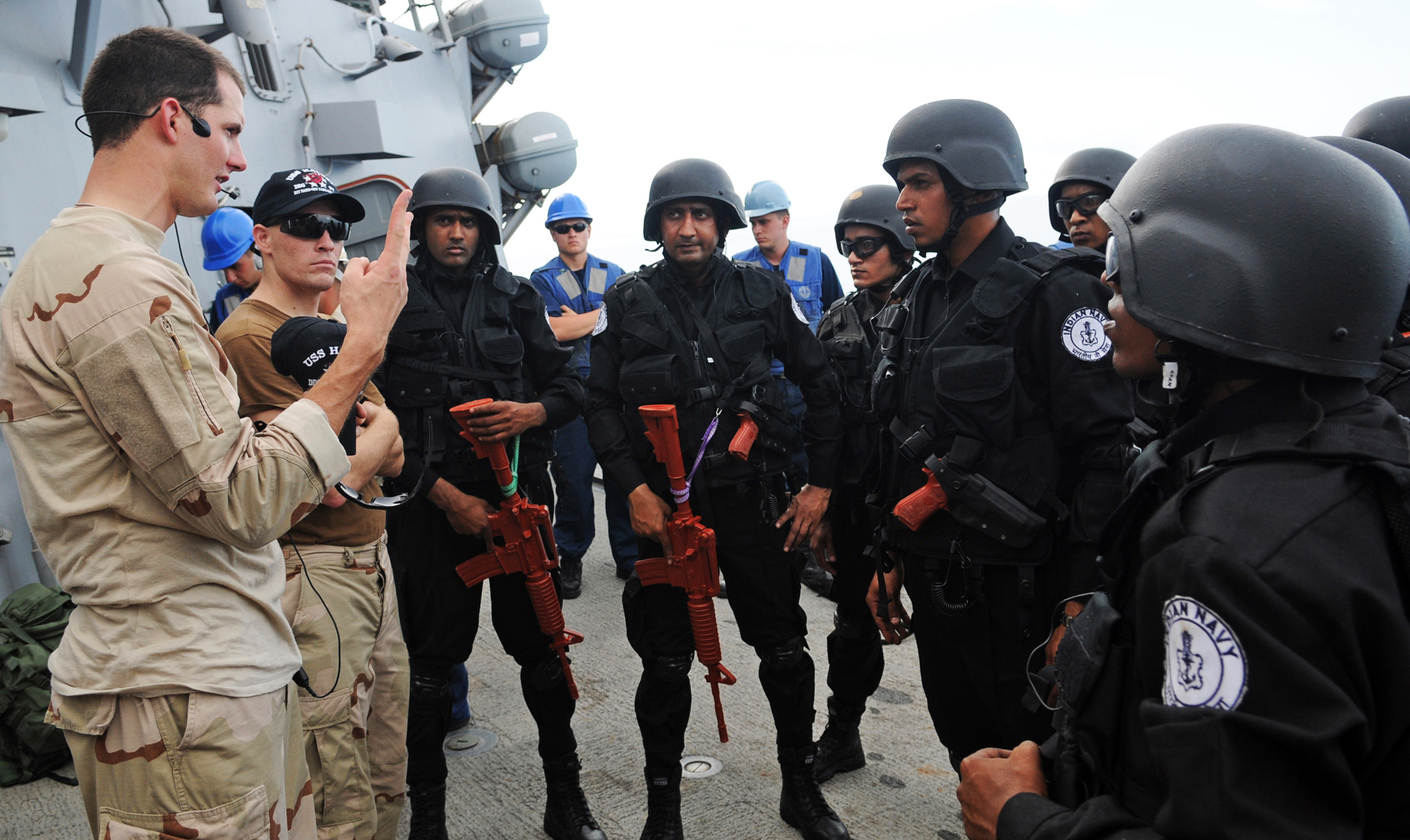 120412-N-ZF681-172 INDIAN OCEAN (April 12, 2012) Ensign Timothy Eick gives a briefing to members of the visit, board search and seizure team assigned to the Indian navy frigate Satpura (F-48) during a training exercise aboard the guided-missile destroyer USS Halsey (DDG 97). Halsey and Satpura are participating in Malabar, a scheduled naval training exercise conducted to advance multinational maritime relationships and mutual security. (U.S. Navy photo by Mass Communication Specialist 3rd Class Christopher Farrington/Released)