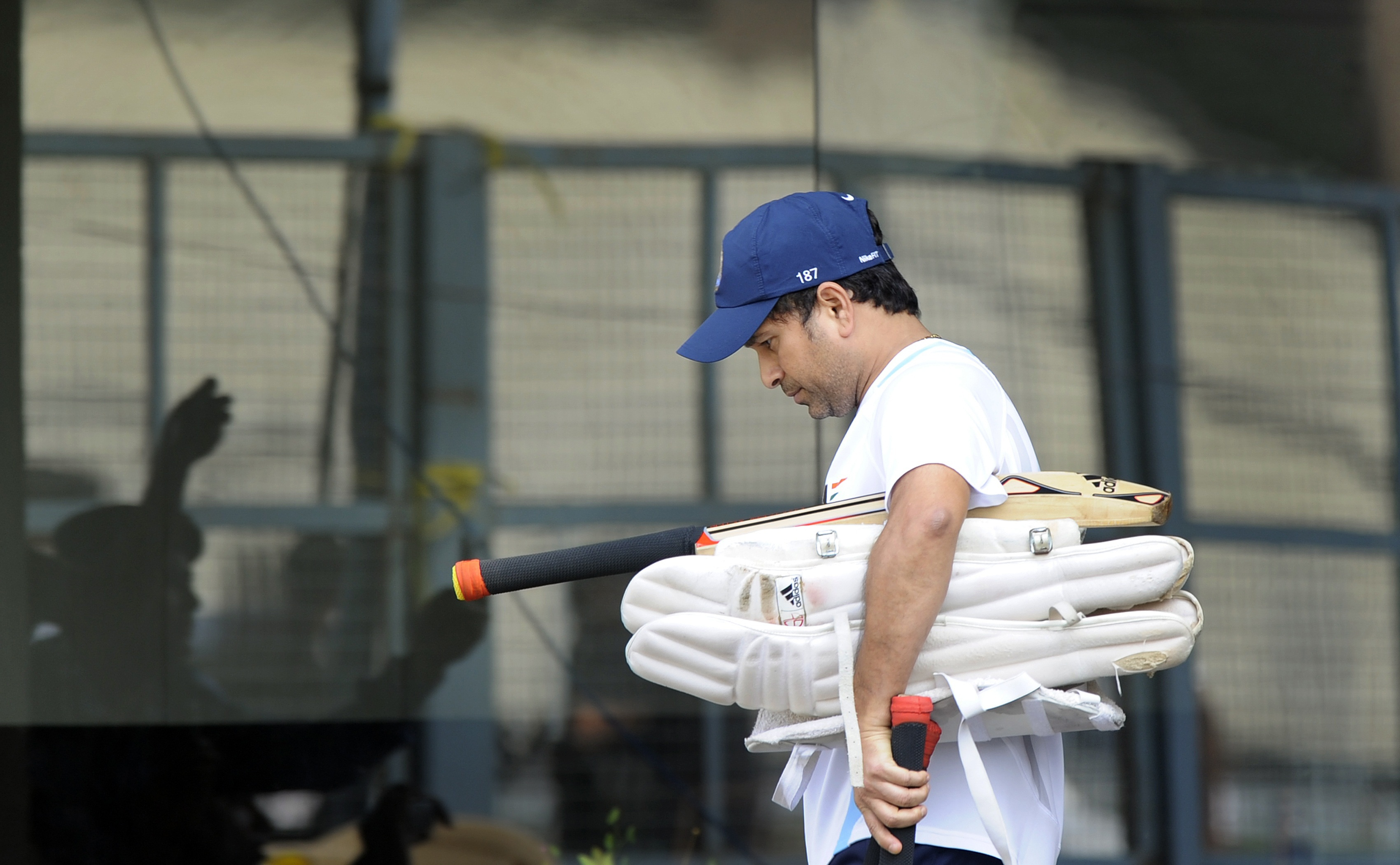 Indian cricketer Sachin Tendulkar walks out of the dressing room for a training session at The Eden Gardens in Kolkata on November 12, 2011. India leads the three-match Test series against the West Indies by 1-0 and will play the Second Test match in Kolkata from November 14. AFP PHOTO/Dibyangshu SARKAR (Photo credit should read DIBYANGSHU SARKAR/AFP/Getty Images)