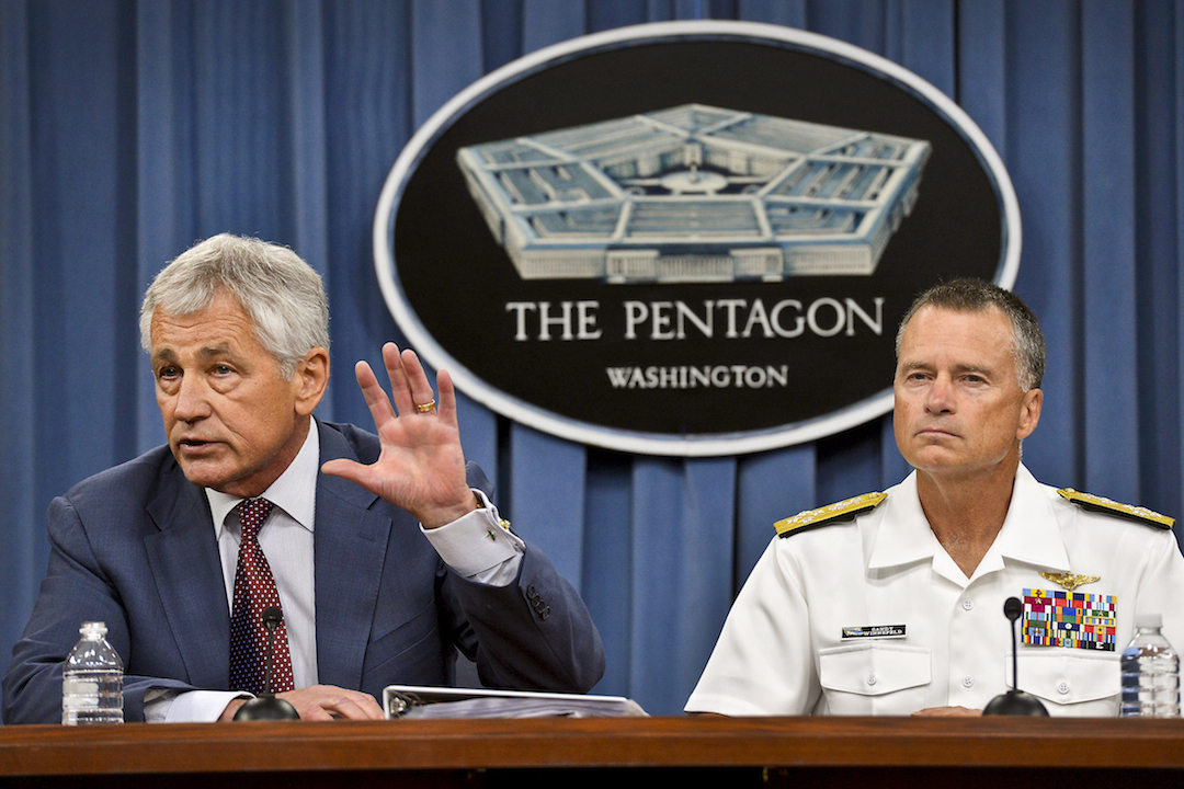 Secretary of Defense Chuck Hagel answers reporters' questions during a Pentagon press briefing on the recent Strategic Choices Management Review in Arlington, Va., on July 31, 2013.  Vice Chairman of the Joint Chiefs of Staff Adm. James Winnefeld Jr. joined Hagel for the briefing. The purpose of the review was to understand the impact of further budget reductions on the Department and develop options to deal with these additional cuts.  DoD photo by Glenn Fawcett. (Released)