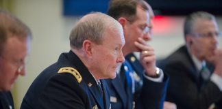 18th Chairman of the Joint Chiefs of Staff Gen. Martin E. Dempsey speaks with is Russian counterpart at the Russian Mission in Brussels, Belgium as apart of a 3-day trip where he will is slated to meet with his NATO and Russian counterparts January 21, 2014. DoD photo by Mass Communication Specialist 1st Class Daniel Hinton