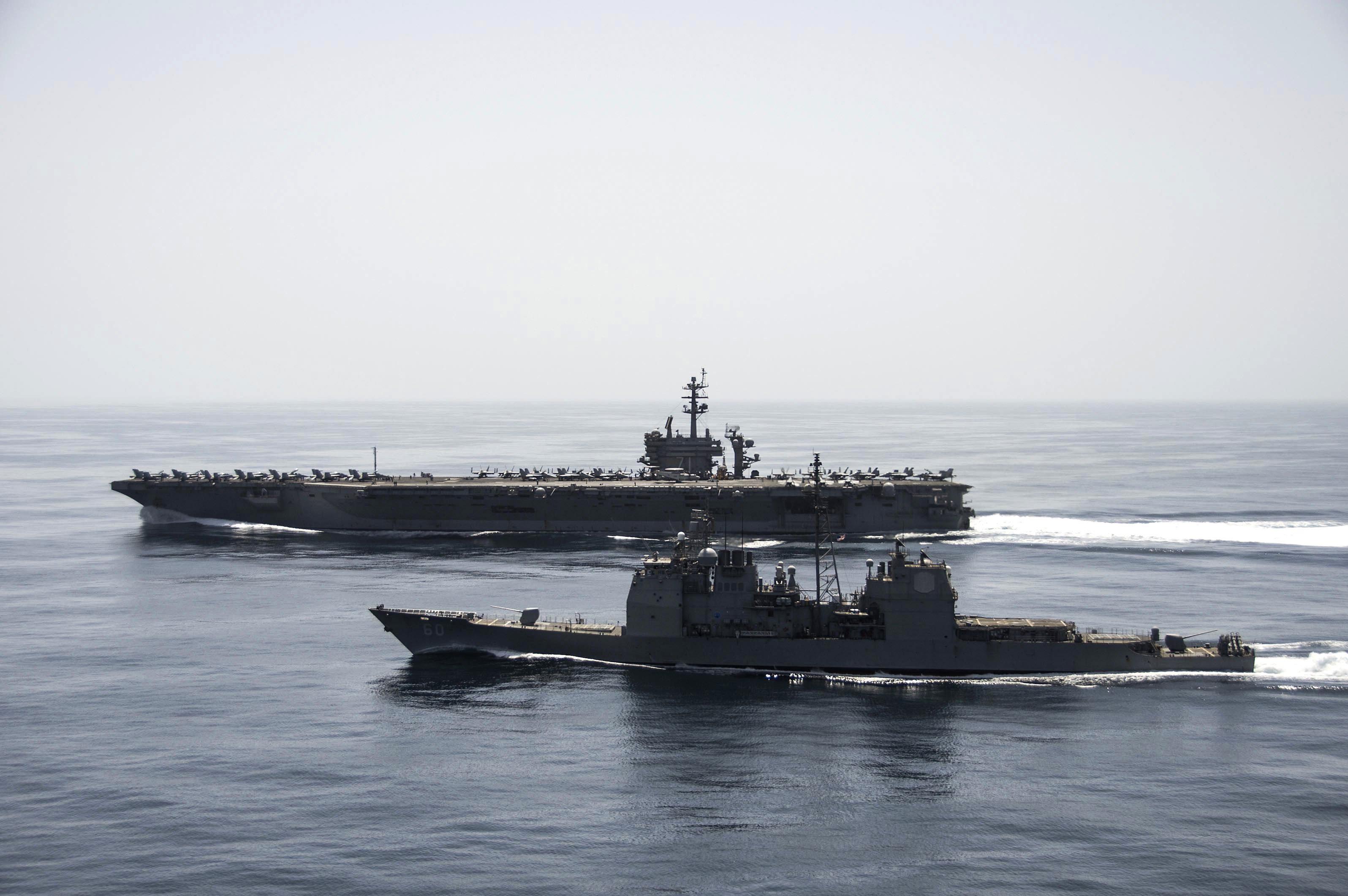 150421-N-ZF498-231 ARABIAN SEA (April 21, 2015) The aircraft carrier USS Theodore Roosevelt (CVN 71) and the guided-missile cruiser USS Normandy (CG 60) operate in the Arabian Sea conducting maritime security operations. (U.S. Navy photo by Mass Communication Specialist 3rd Class Anthony N. Hilkowski/Released)