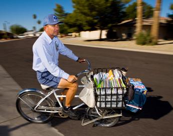 Sun City AZ letter carrier Daniel J. Stawarski delivering mail with bicycle.