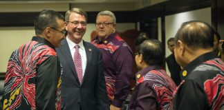 Secretary of Defense Ash Carter speaks with several defense officials during a reception at the Association of Southeast Asian Nations Defense Ministers Meeting Plus in Kuala Lumpur, Malaysia Nov. 3, 2015. (Photo by Senior Master Sgt. Adrian Cadiz)(Released)