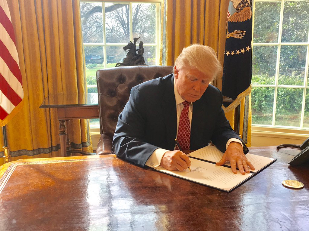 Presdient Trump signing New Travel Ban