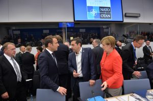 Emmanuel Macron (President, France) with Alexis Tsipras (Prime Minister, Greece) and Angela Merkel (Federal Chancellor, Germany)
