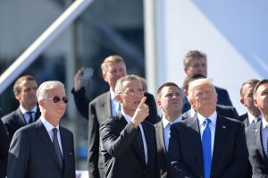 NATO Secretary General Jens Stoltenberg observes the fly-past together with HM King Philippe of Belgium (King of the Belgians) and Donald Trump (President, United States)