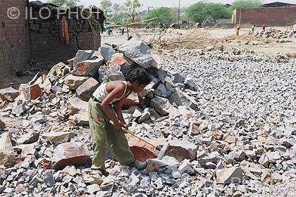 Child breaking stones India ILP