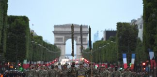PARIS (July 12, 2017) Almost 200 U.S. Soldiers, Sailors, Marines and Airmen assigned to units in Europe and the 1st Infantry Division, Fort Riley, Kansas, march from the Arc de Triomphe to the Place de la Concorde during a rehearsal for the Military Parade on Bastille Day to be held July 14, 2017. This year, the U.S. will lead the parade as the country of honor in commemoration of the centennial of U.S. entry into World War I – as well as the long-standing partnership between France and the U.S. (U.S. Navy photo by Chief Mass Communication Specialist Michael McNabb/Released)