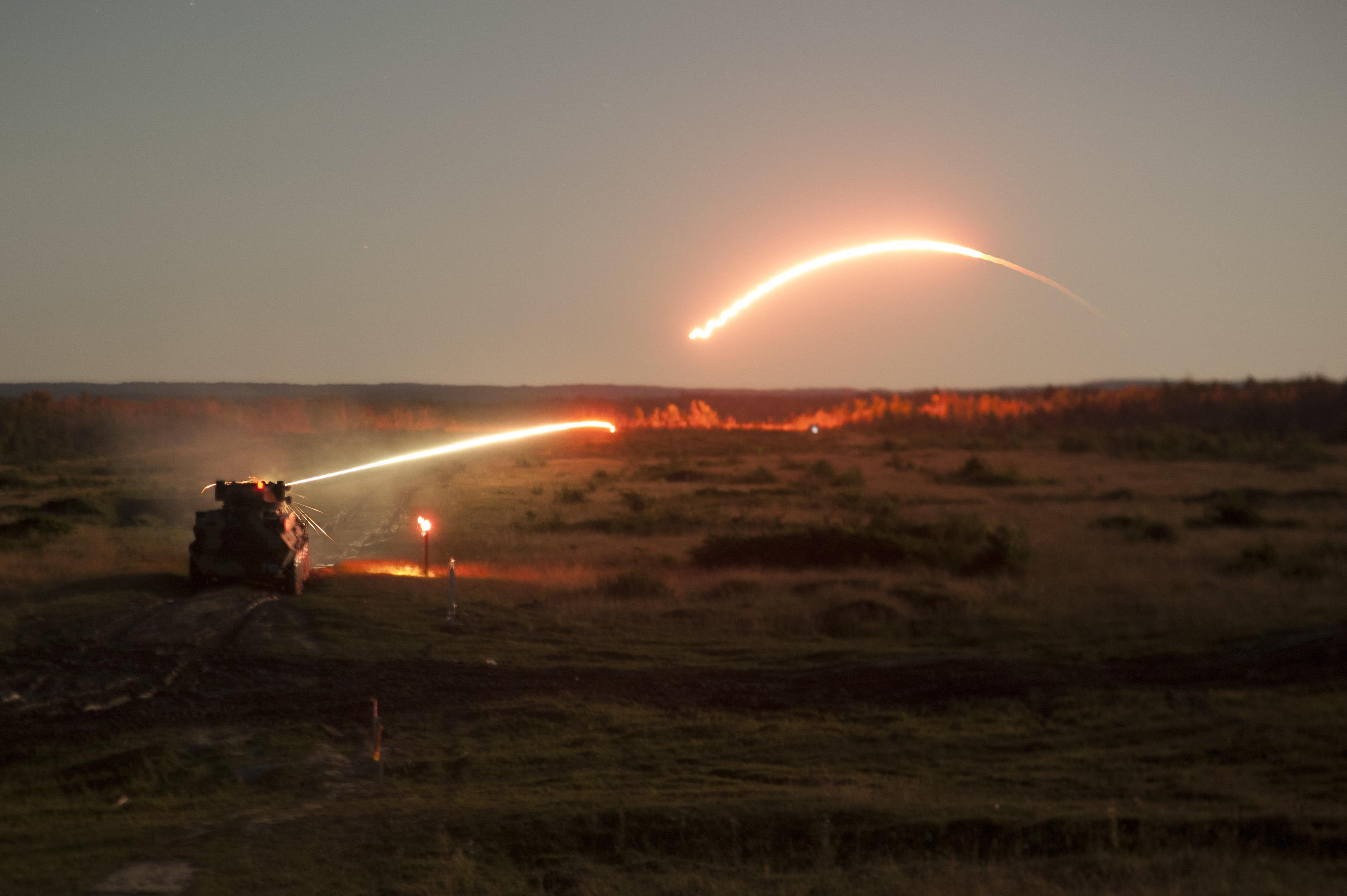BTRs engage targets after dark at Yavoriv CTC