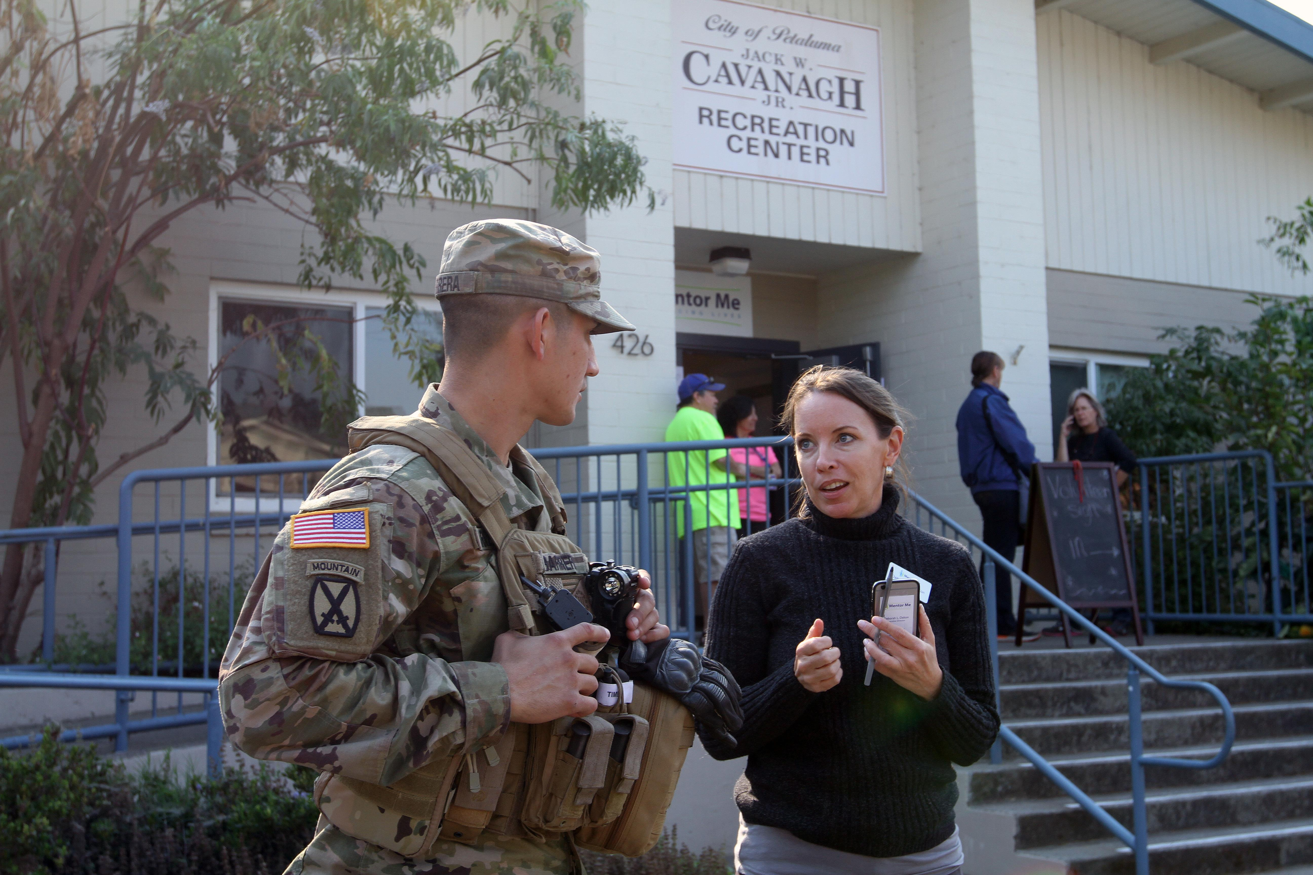 CA Guardsmen assist fire evacuation center