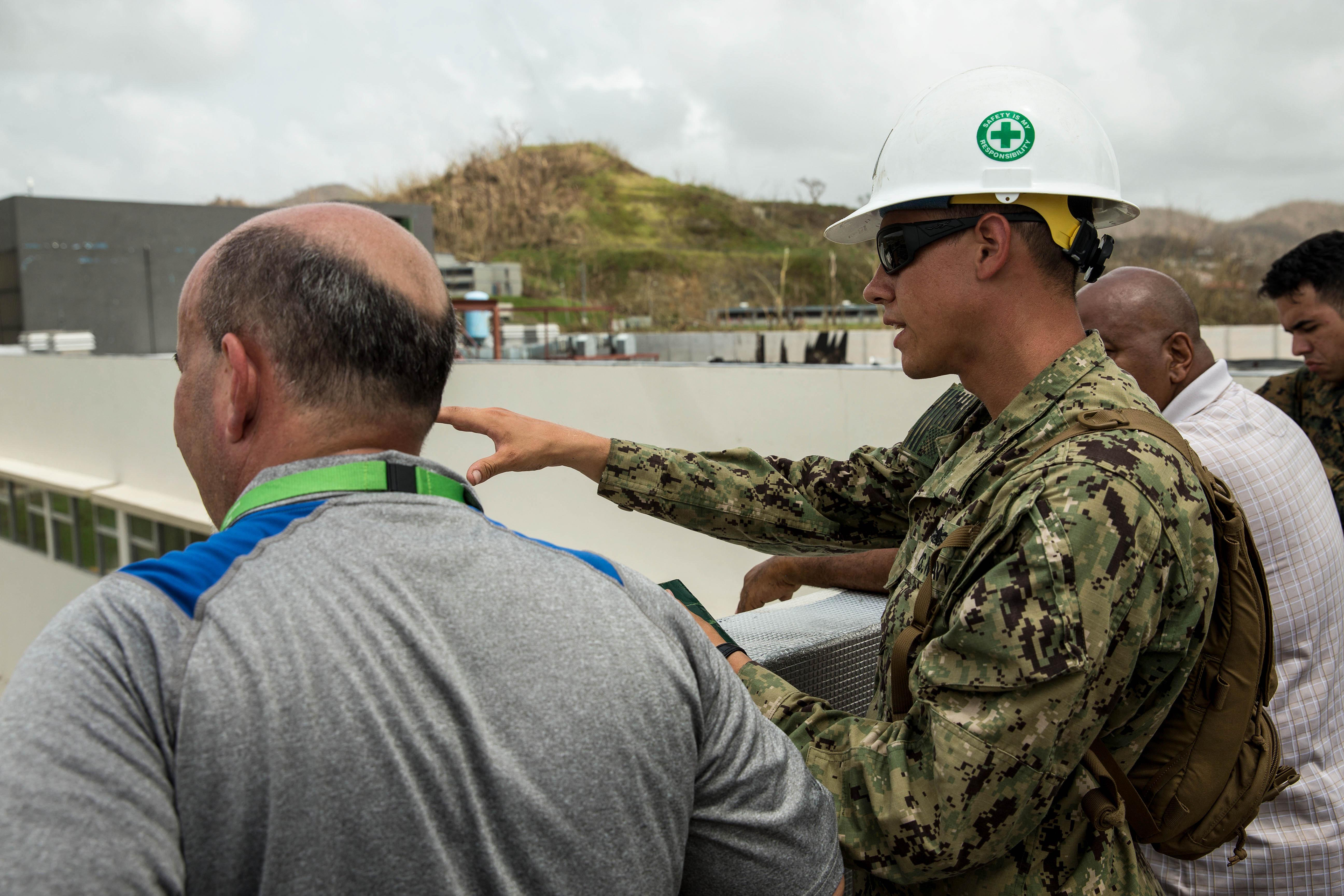U.S. Navy Lt. Colin A. Roberts, a civil engineer core inspector with Amphibious Construction Battalion 2, speaks with local civilian employees during an assessment of Ryder Hospital's medical and operational needs as part of Hurricane Maria relief efforts at Humacao, Puerto Rico, Sept. 27, 2017. The 26th Marine Expeditionary Unit, along with other services of the Department of Defense, is supporting the Federal Emergency Management Agency, the lead federal agency, and local authorities in Puerto Rico with the combined goal of protecting the lives and safety of those in affected areas. (U.S. Marine Corps photo by Lance Cpl. Tojyea G. Matally)