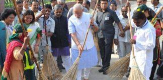 Modi with broom