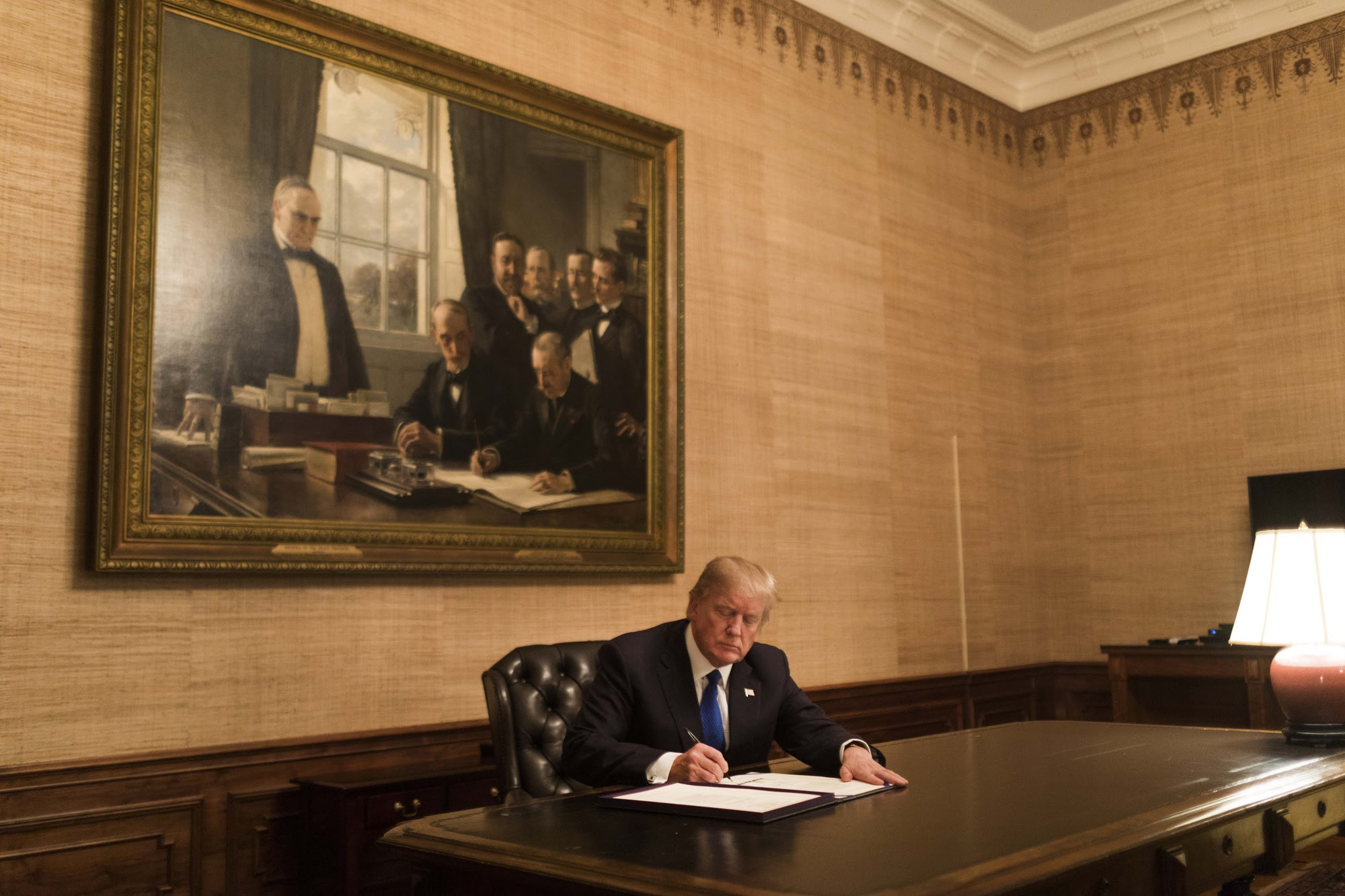 President Trump signs a bill in the Treaty Room at the White House