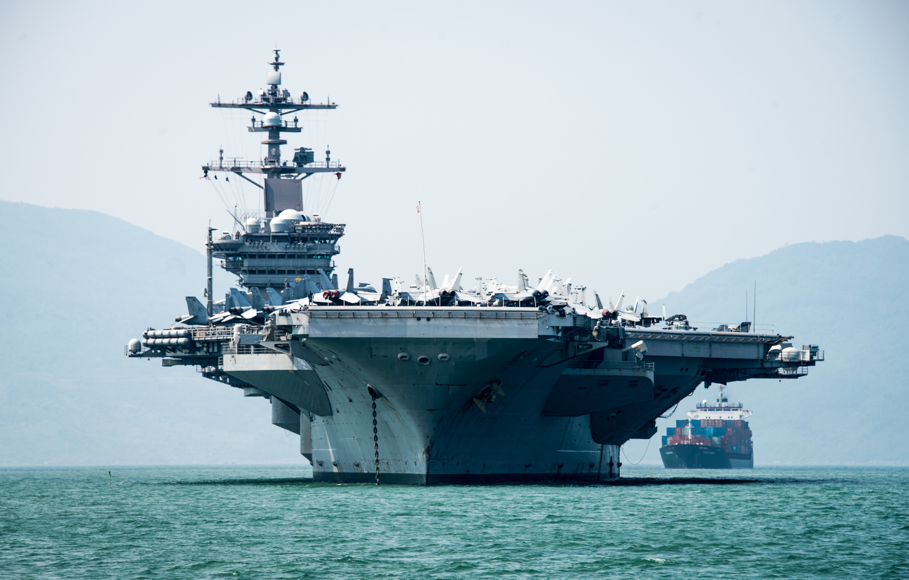 180305-N-BS159-0039 DA NANG, Vietnam (March 5, 2018) The Nimitz-class aircraft carrier USS Carl Vinson (CVN 70) arrives in Da Nang, Vietnam for a scheduled port visit. The Carl Vinson Strike Group is in the Western Pacific as part of a regularly scheduled deployment. (U.S. Navy photo by Mass Communication Specialist 3rd Class Devin M. Monroe/Released)