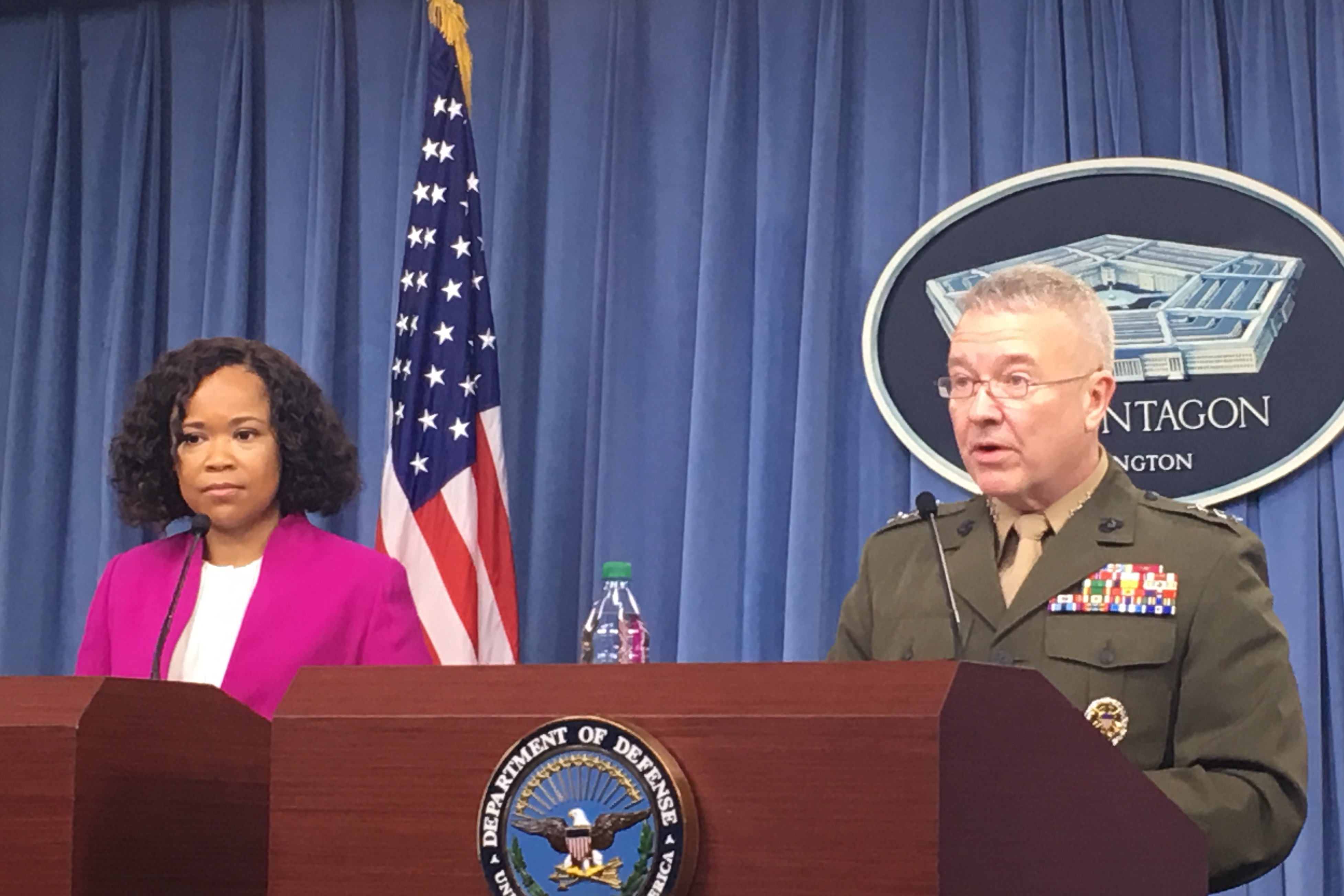 Dana W. White and Marine Corps Lt. Gen. Kenneth F. McKenzie, the Joint Staff director