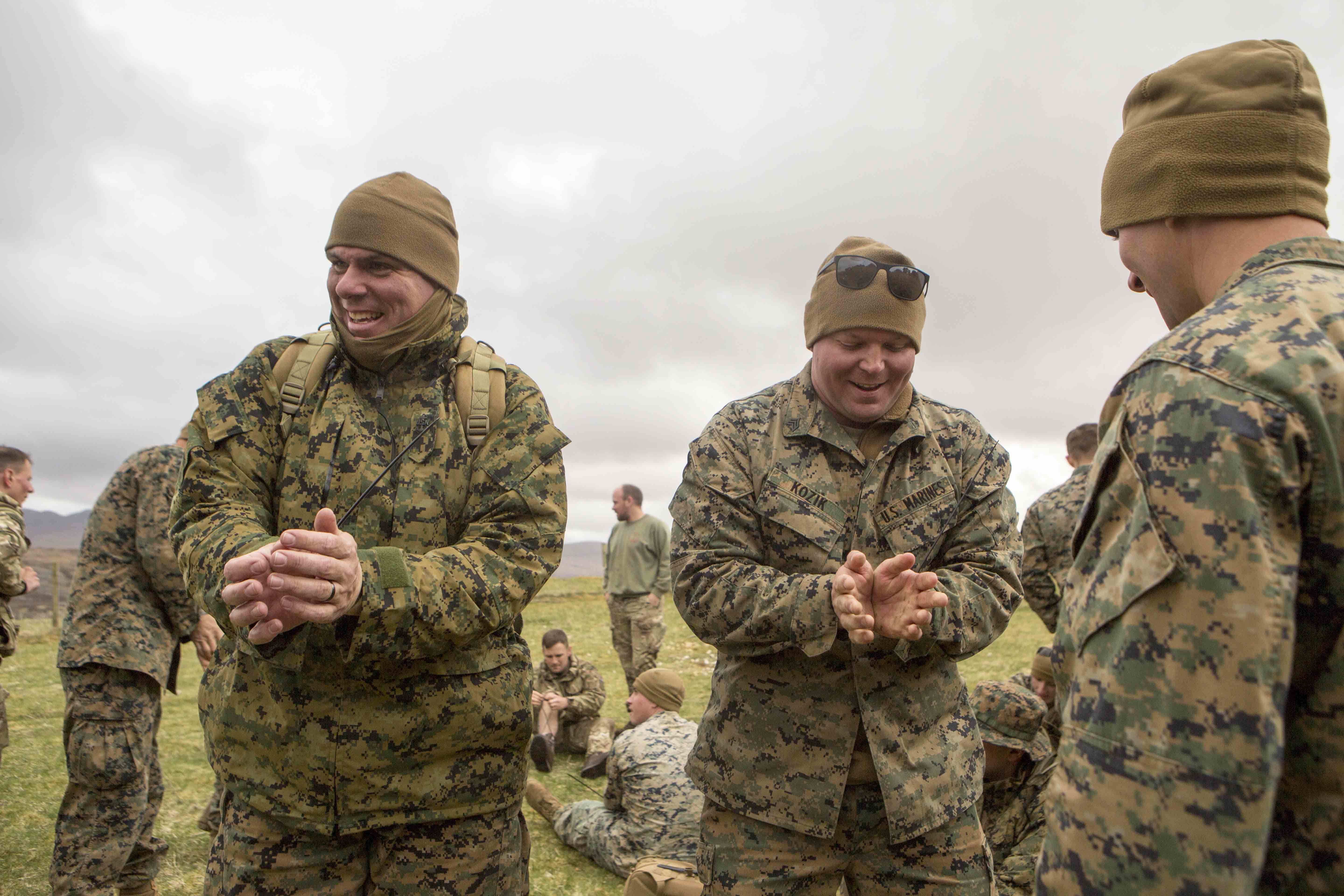 U.S. Navy Chief Petty Officer Rafael Corrada (left), corpsman with 4th Air Naval Gunfire Liaison Company, Force Headquarters Group, and U.S. Marine Corps Sgt. Michael Kozik, joint fires observer with 4th ANGLICO, FHG, attempt to escape from zip-tie handcuffs during survival training, in Durness, Scotland, April 26, 2018. 4th ANGLICO is in Scotland to take part in Joint Warrior 18-1, an exercise that furthers their readiness and effectiveness in combined arms integration, small unit tactics and land navigation. This training aims at improving their capabilities and combat effectiveness and ensures they're ready to fight tonight.