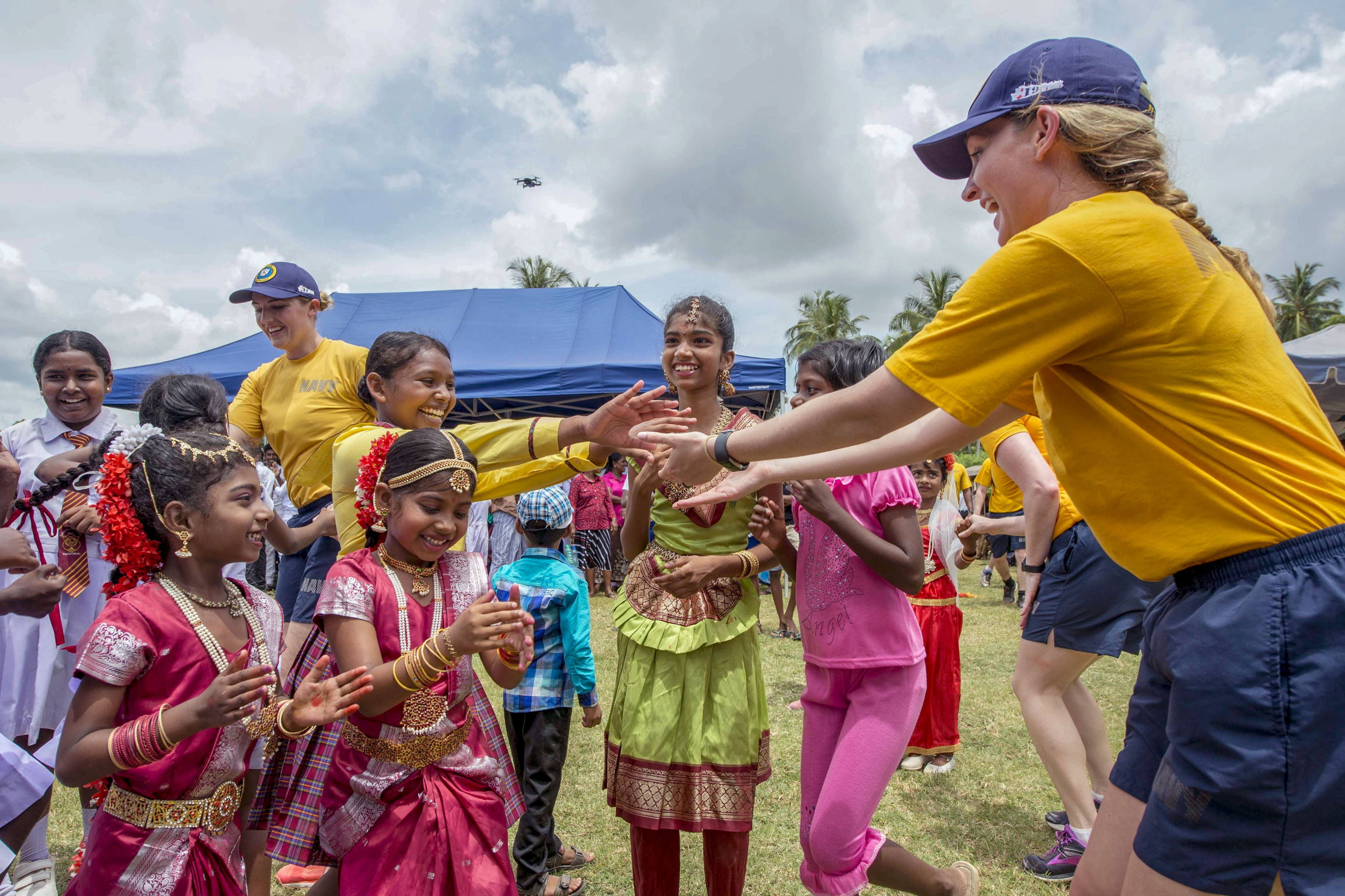 180428-N-MD713-0028  TRINCOMOLEE, Sri Lanka (April 28, 2018) Sailors assigned to Military Sealift Command hospital ship USNS Mercy (T-AH 19) dance with students from T/mu/Paddithidal Maha Vidyalayam School during a U.S. Pacific Fleet Band performance in support of Pacific Partnership 2018 (PP18).  PP18's mission is to work collectively with host and partner nations to enhance regional interoperability and disaster response capabilities, increase stability and security in the region, and foster new and enduring friendships across the Indo-Pacific Region. Pacific Partnership, now in its 13th iteration, is the largest annual multinational humanitarian assistance and disaster relief preparedness mission conducted in the Indo-Pacific. (U.S. Navy photo by Mass Communication Specialist 3rd Class Cameron Pinske/Released)