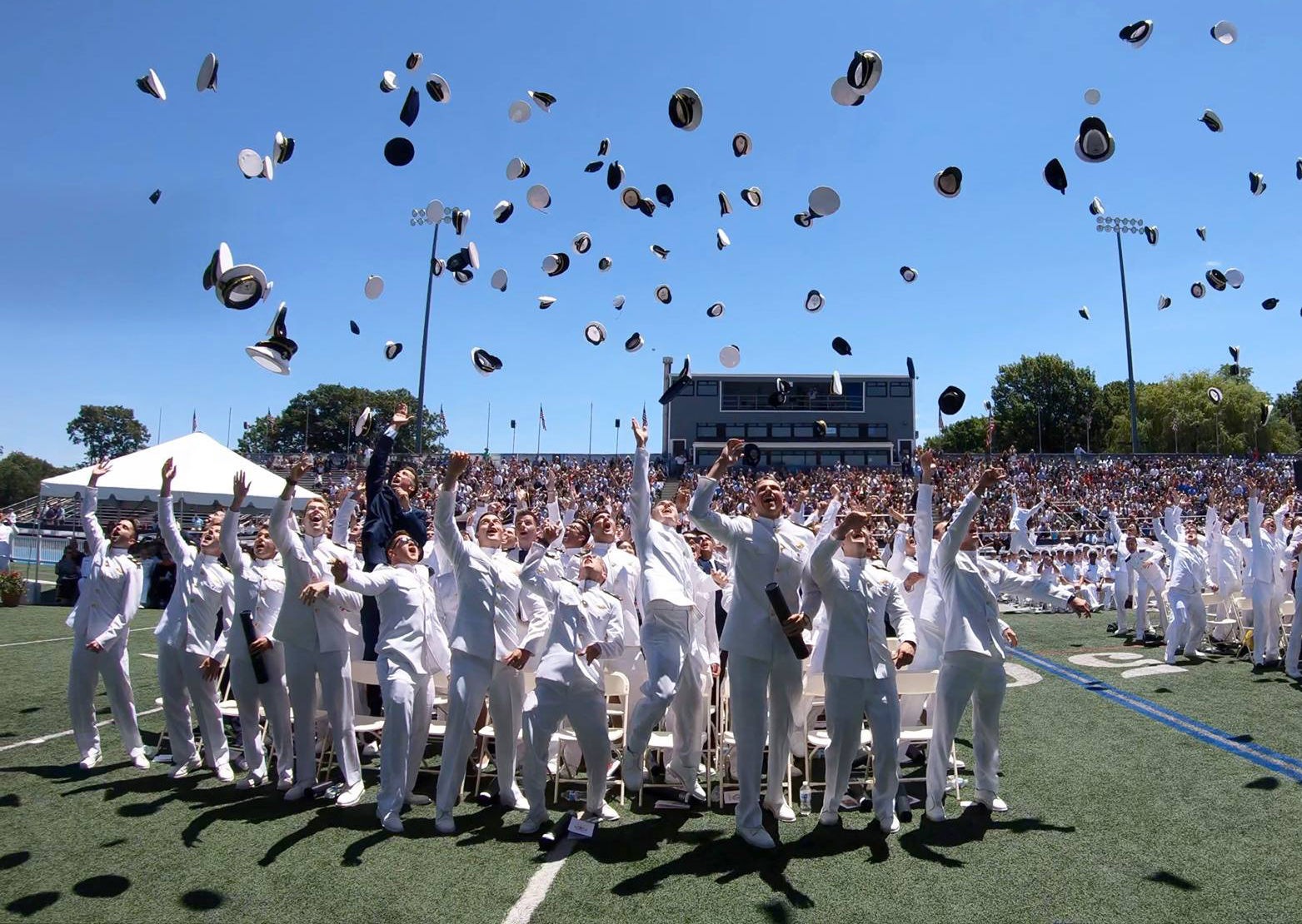 Graduates of the U.S. Merchant Marine Academy's class of 2018 celebrate at Kings Point, New York