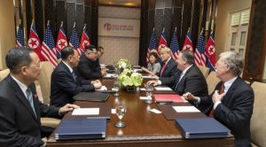 Trump Kim on table f2f