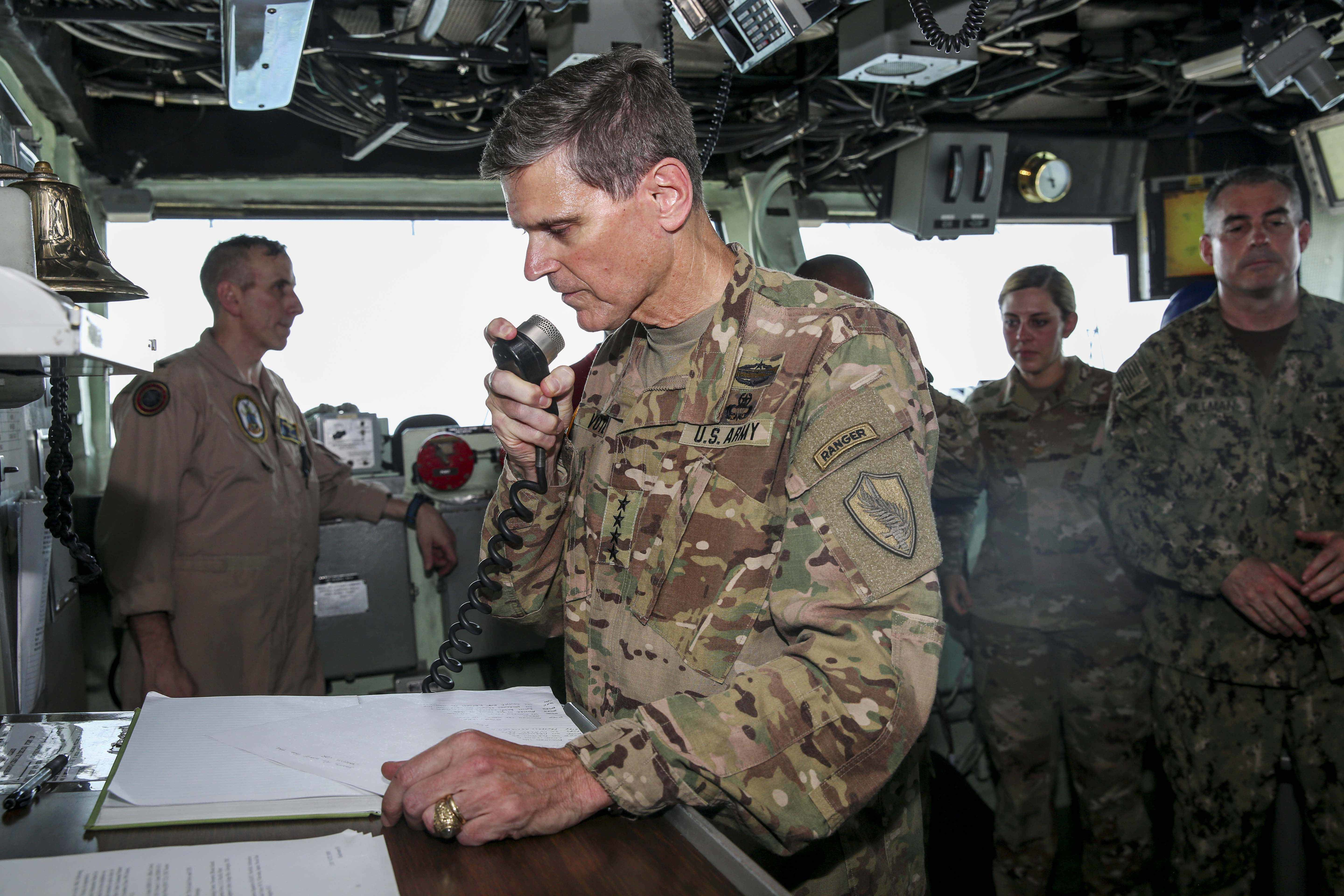 ARABIAN GULF (June 22, 2018) U.S. Army Gen. Joseph Votel, commander, U.S. Central Command, addresses the Marines and Sailors aboard the Wasp-class amphibious assault ship USS Iwo Jima (LHD 7), June 22, 2018. Votel, Vice Adm. Scott Stearney, commander, U.S. Naval Forces Central Command, and other distinguished visitors took a tour of Iwo Jima and spoke with crew members and Marines with the 26th Marine Expeditionary Unit, who are currently deployed to the U.S. 5th Fleet of operations in support of maritime security operations to reassure allies and partners and preserve the freedom of navigation and the free flow of commerce in the region. (U.S. Marine Corps photo by Cpl. Jon Sosner/Released)