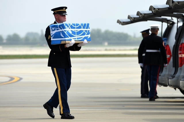 United Nations Honor Guard member carries remains during a dignified return ceremony at Osan Air Base, Republic of Korea, Friday. Members of the command and the Osan community were on hand at the arrival ceremony. (Photo by U.S. Air Force Senior Airman Kelsey Tucker.)