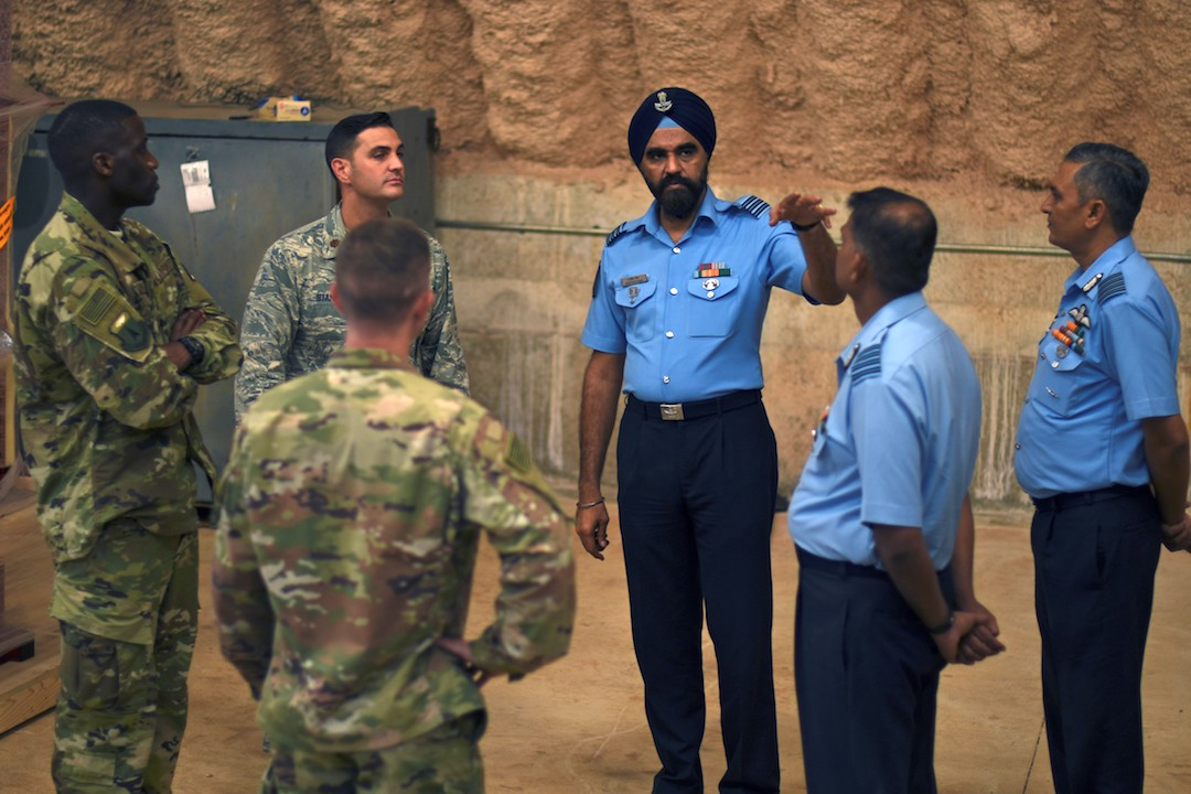 U.S. Air Force 36th Contingency Response Group Airmen speak with India Air Force Subject Matter Experts during a Security Forces SMEE July 23, 2018, on Andersen Air Force Base, Guam. (U.S. Air Force photo by Airman 1st Class Gerald R. Willis)
