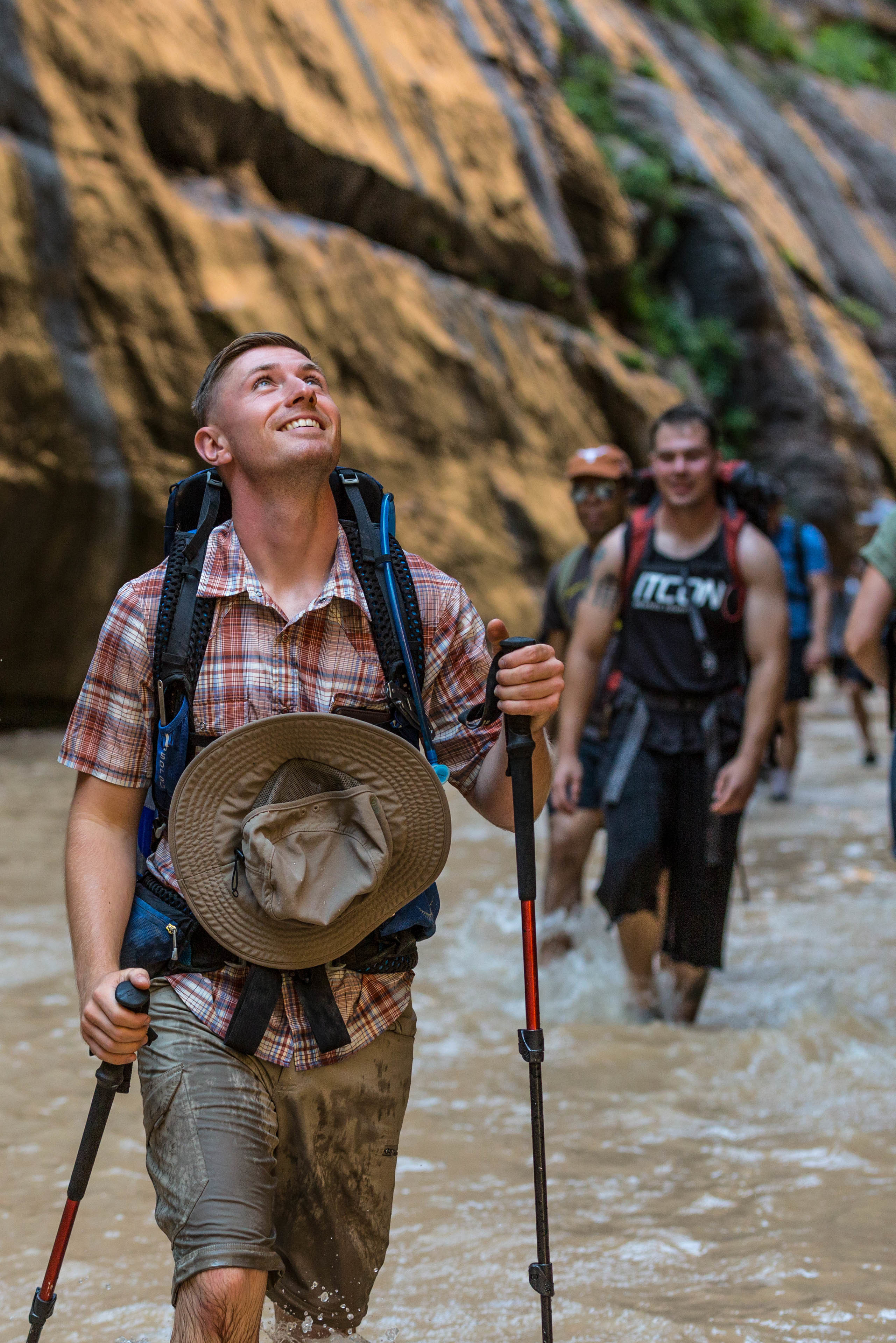 U.S. Marine Corps Sgt. Brehm Rhett, ground radio repairman, 1st Intelligence Battalion, I Marine Expeditionary Force-Information Group, admires the towering canyon walls during a hike at Zion National Park, Utah, Aug. 4, 2018. Single Marine Program trips are events only single active-duty service members and those dislocated from their spouses can participate in. (U.S. Marine Corps photo by Lance Cpl. Baylee Boggs)