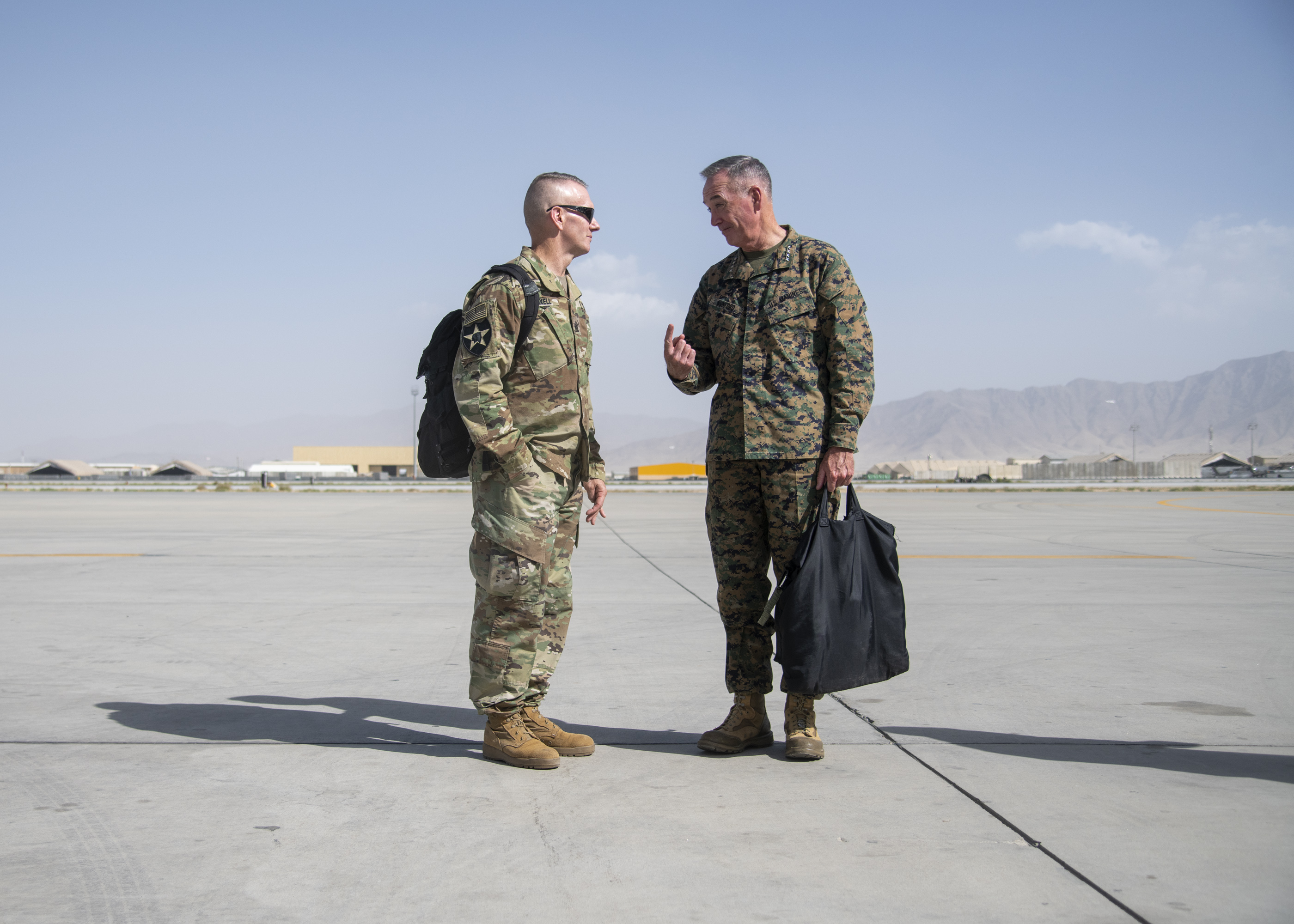 Marine Corps Gen. Joe Dunford, chairman of the Joint Chiefs of Staff, speaks with Army Command Sgt. Maj. John W. Troxell, senior enlisted advisor to the chairman on the Joint Chiefs of Staff at Bagram Airfield, Sept. 7, 2018. (DoD Photo by Navy Petty Officer 1st Class Dominique A. Pineiro)
